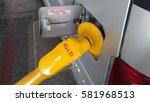 petrol pump filling the car... | Shutterstock . vector #581968513