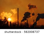 nice sunset and steaming steel... | Shutterstock . vector #582008737