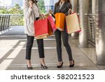 two woman shopping at the city
