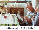 positive loving couple enjoying ... | Shutterstock . vector #582040873