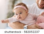 involved toddler lying in the... | Shutterstock . vector #582052237