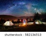 night camping. pair hikers... | Shutterstock . vector #582136513