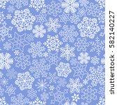 seamless white snowflakes on... | Shutterstock . vector #582140227