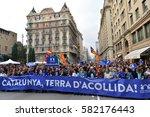 demonstrators march in... | Shutterstock . vector #582176443
