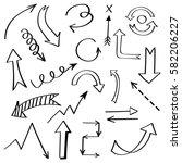 set of hand drawn arrow doodle... | Shutterstock .eps vector #582206227