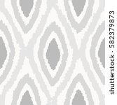 grey rhombus seamless pattern.... | Shutterstock .eps vector #582379873