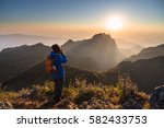 woman take a photo from top of... | Shutterstock . vector #582433753