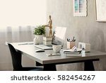 workplace with laptop on table... | Shutterstock . vector #582454267