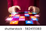 hand holding tablet device with ... | Shutterstock . vector #582455383