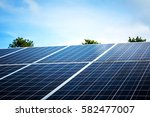 solar panels with blue sky | Shutterstock . vector #582477007