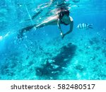 beautiful woman snorkeling... | Shutterstock . vector #582480517