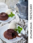 Small photo of Chocolate fondant - lava cake with vanilla ice cream, copy space