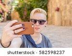 november 22  a young blond... | Shutterstock . vector #582598237