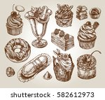 ink hand drawn set of cupcakes  ... | Shutterstock .eps vector #582612973