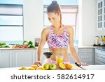 smiling woman with muscular... | Shutterstock . vector #582614917