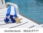 starfish and beach chair at... | Shutterstock . vector #582619777
