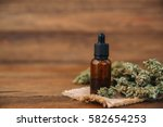 Small photo of Medicinal cannabis with extract oil in a bottle