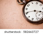 antique pocket watch on old... | Shutterstock . vector #582663727
