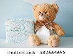 teddy bear dressed in diaper | Shutterstock . vector #582664693