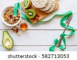 healthy organic food on white... | Shutterstock . vector #582713053