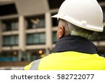 rear view of building inspector ... | Shutterstock . vector #582722077