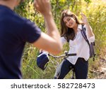 young asian woman on bicycle... | Shutterstock . vector #582728473