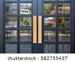 open sign board hanging on door ... | Shutterstock . vector #582755437