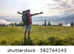hiker with a backpack standing...   Shutterstock . vector #582764143