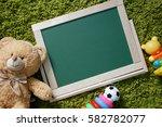 kids chalkboard. frame with a... | Shutterstock . vector #582782077