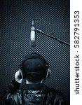 back of male singer singing in... | Shutterstock . vector #582791353