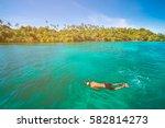 men swimming with snorkel ...   Shutterstock . vector #582814273