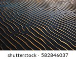 sand ripples on a beach with... | Shutterstock . vector #582846037
