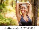 beautiful young woman doing... | Shutterstock . vector #582848437