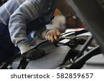 a mechanic in the workshop | Shutterstock . vector #582859657