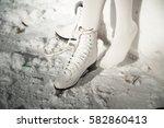 she puts on skates. girl lace... | Shutterstock . vector #582860413
