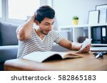 worried man counting home... | Shutterstock . vector #582865183