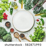 fresh raw greens  vegetables... | Shutterstock . vector #582871993