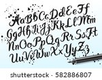 hand drawn brushpen alphabet... | Shutterstock .eps vector #582886807