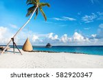 beautiful tropical maldives... | Shutterstock . vector #582920347