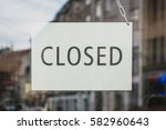 closed sign in shop entrance... | Shutterstock . vector #582960643