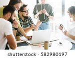 smm specialists are discussing... | Shutterstock . vector #582980197