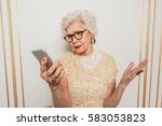 confused senior woman using... | Shutterstock . vector #583053823
