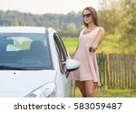 attractive girl driver holding... | Shutterstock . vector #583059487