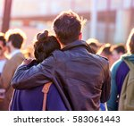 a couple in a concert.   Shutterstock . vector #583061443
