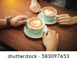 hands of couple drinking coffee ... | Shutterstock . vector #583097653