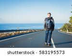 young man with a backpack walks ... | Shutterstock . vector #583195573