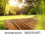 wooden desk and spring time  | Shutterstock . vector #583251457