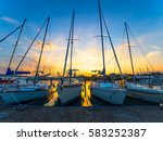Sunset Behind Boats Docked On...