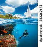 young woman doing scuba diving... | Shutterstock . vector #583260673