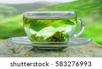 Stock photo green tea time green tea leaves at the bottom of the cup hot tea green tea on a background of 583276993